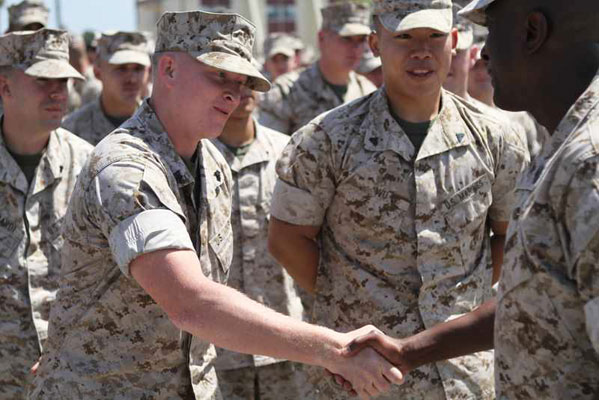Image of two marines shaking hands